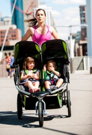 mom pushing a double BOB jogging stroller
