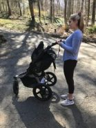 woman lifting a jogging stroller
