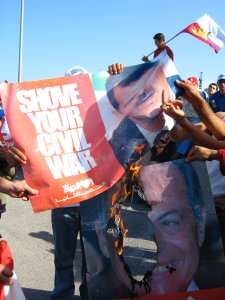 Opponents of Syria's President Bashir Assad and Lebanese President Emile Lahoud, a Syrian ally, vent their rage on the images of the men.