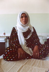 """Hameda Farag, 46, a victim of 1988 Halabja attack, photographed in Halabja's single hospital. It was near sunset when she smelled something odd. """"I didn't know it was a chemical attack until I fled to Iran,"""" she said. She was pregnant at the time and lost the child. Since then, she has had three miscarriages and now can no longer have children. At the time, the world didn't care. The United States still doesn't. ®2002 Christopher"""