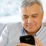 Portrait of senior man using smartphone