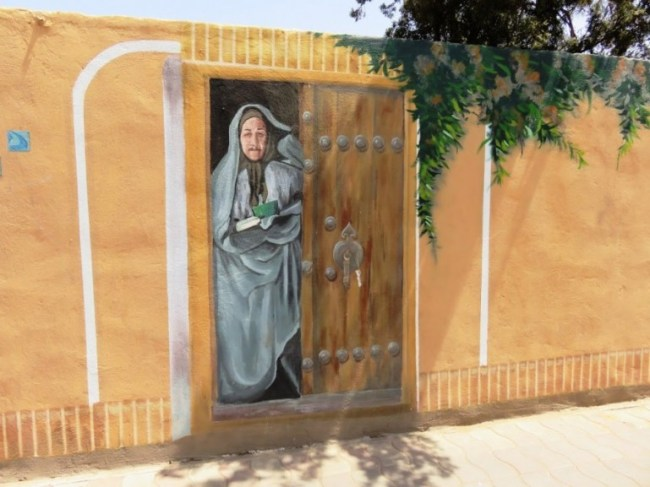 painting on a wall in the old town of Yazd. Wandering around the old town is one of the best things to do in Yazd