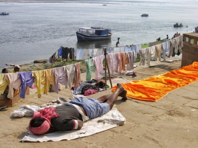 Clothes hanging to dry at Pandey Ghat in Varanasi. One of the best places to see in Varanasi