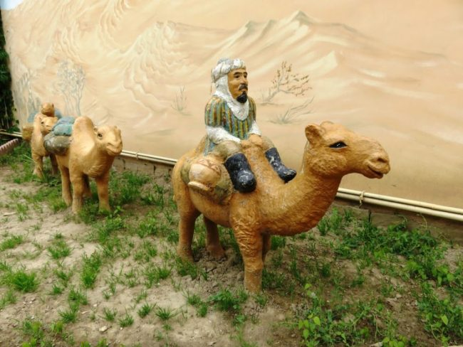 a painting of camels on the silk road in Shymkent