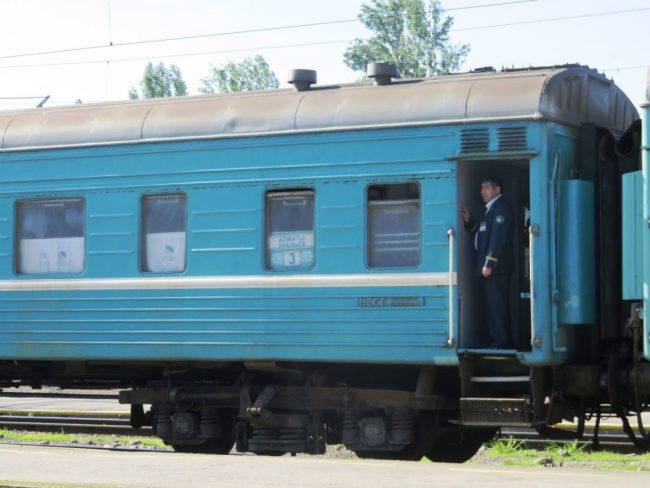 Backpacking Kazakhstan by train on the older blue trains like these are an adventure