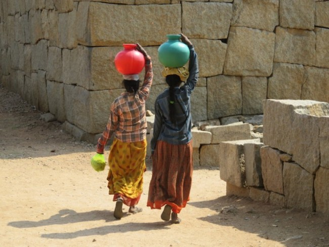 Ladies carrying water in Hampi