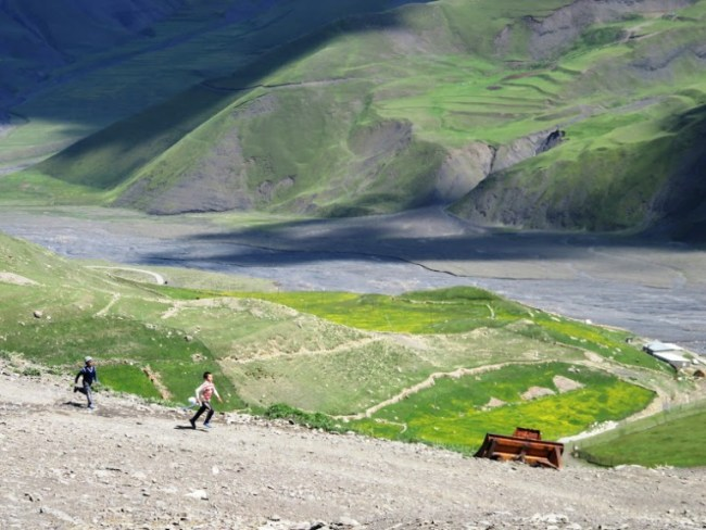 three boys running in the village of Xinaliq, Khinaliq, Khinalug in Azerbaijan