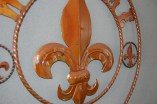 Copper colored fleur de lis
