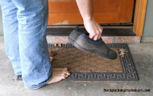 Removing your shoes before entering a house. You should always respect people's practices. If they do it, you should too.