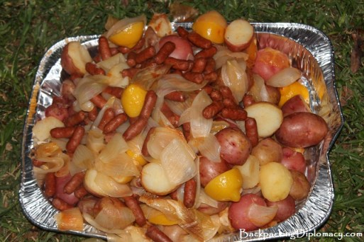 Sausages, corn, potatoes, onions, and lemos added to crawfish boi.
