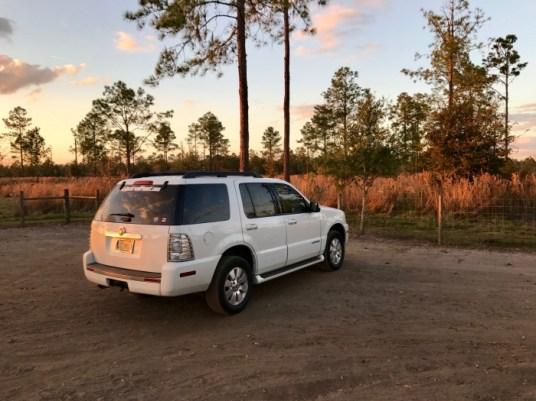 Mercury Mountaineer parked at sunset