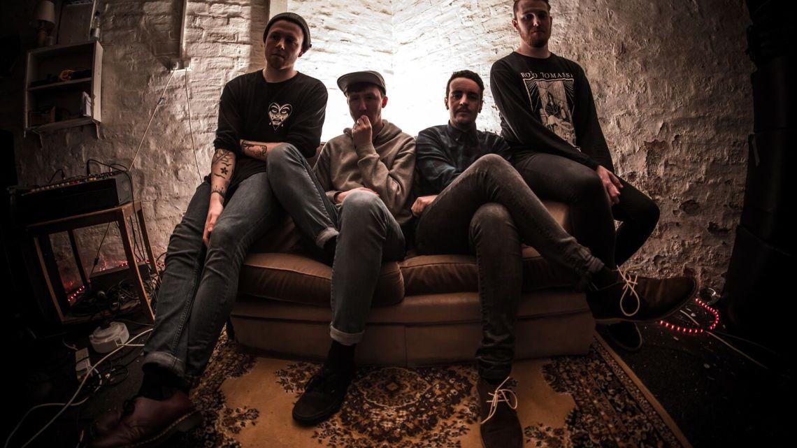 Promo image of Toy Mountains band sitting on sofa