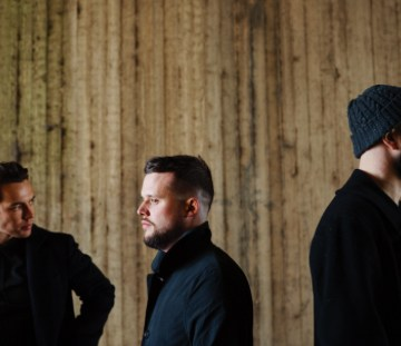 Promo image of White Lies band for Don't Want To Feel It All video
