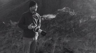 A wolf patrol volunteer with camera