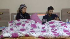 Mahmoud and his wife talking in bed