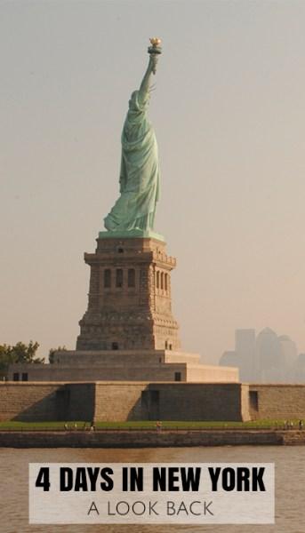 Statue of Liberty looking across a hazy New York Bay towards Manhattan