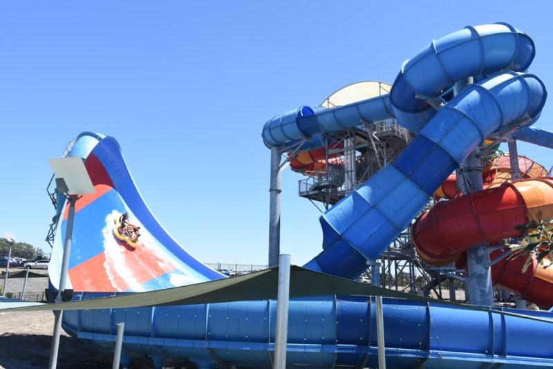 Punters sliding vertically up the Bombora Slide