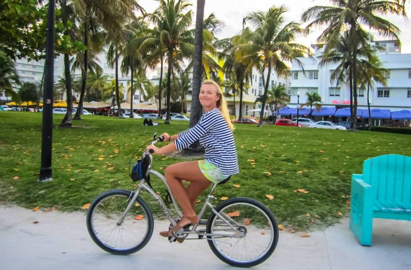 Kynie on a bike in Miami Beach-sm