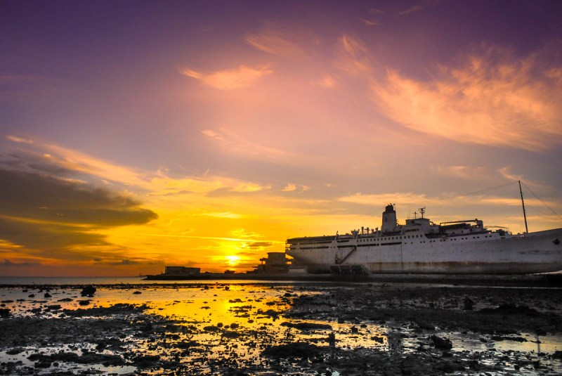Sunset in Bintan Island with a grounded ship
