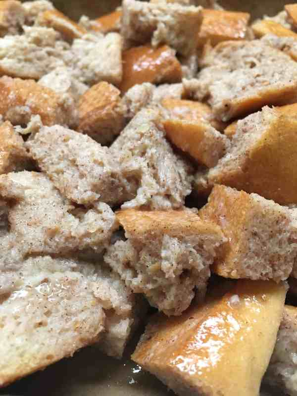 Cinnamon Spiced Bread Pudding with Butter Sauce is an easy and cheap treat for the Christmas holiday. I love the spice-filled taste with the creamy sauce.