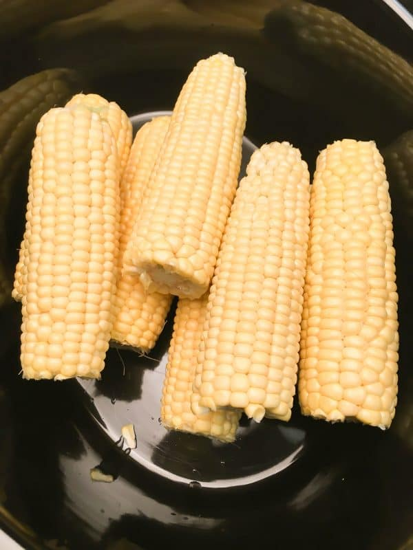 Crock Pot Corn on the Cob with Coconut Milk is an easy recipe. The coconut milk and butter give the corn and soft and buttery taste. The budget-friendly side dish comes out perfect in the slow cooker.