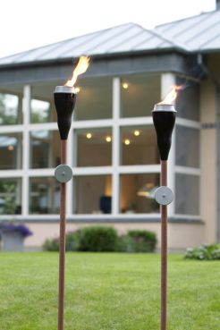 Garden torches give soft elegant light to your backyard outdoor garden workwithnaturefo
