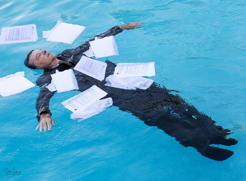 Drowning in paperwork concept photo