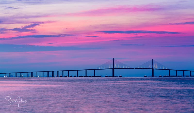 Sunrise over Sunshine Skyway bridge near St Petersburg in Florida
