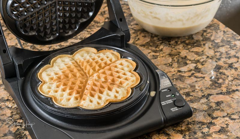 Norwegian heart shaped waffle maker on granite kitchen worktop
