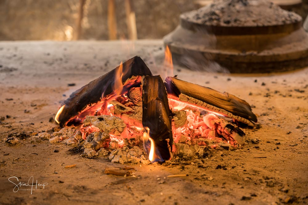 Burning ambers from wood fire in old kitchen stock photo