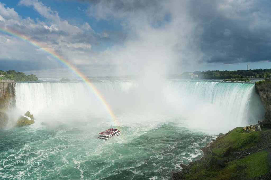 Niagara Falls from the Canadian side as one of the tourist boats approaches the spray