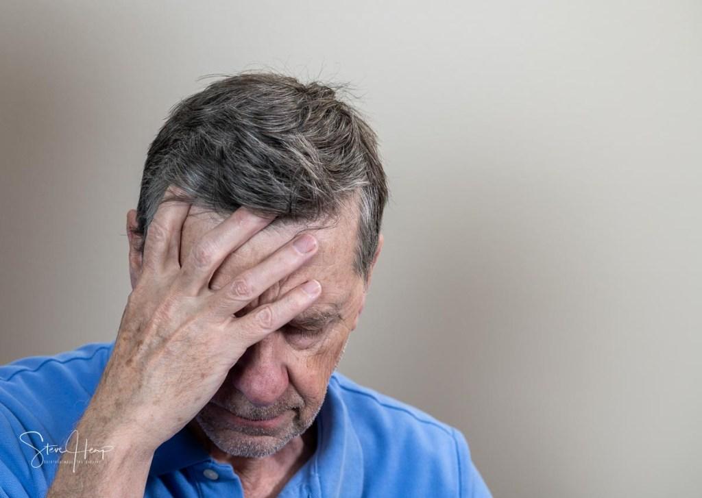 Senior man feeling depressed and lonely stock photo image