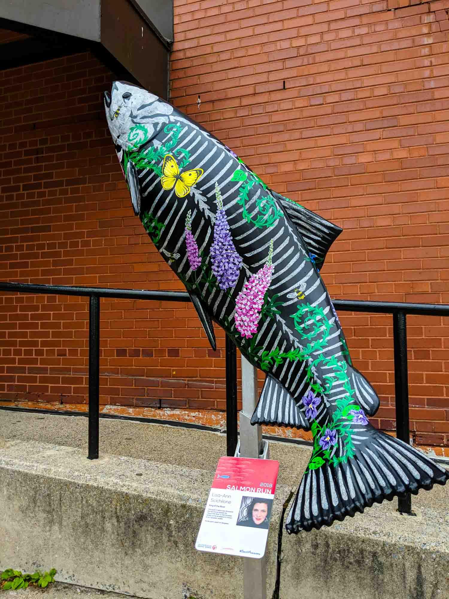 Painted salmon artwork in Saint John