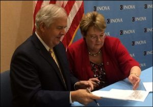 Inova CEO Knox Singleton and UVa President Teresa Sullivan sign partnership deal. Photo credit: Washington Business Journal