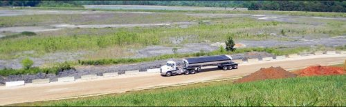 A truck embarks upon coal ash clean-up at a Duke Energy.