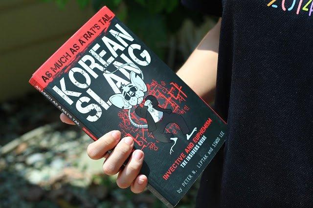 Korean Slang: 쥐꼬리만큼 2nd Edition in hand