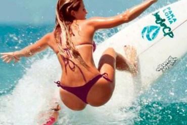 Daily Fresh Baked Randomness girl surfing in the ocean