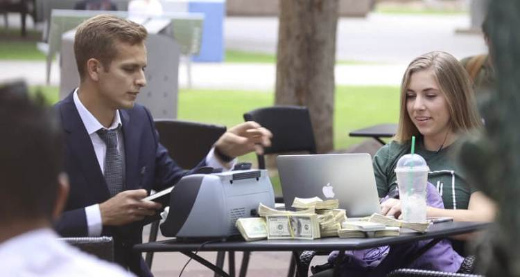 Counting a Pile of Cash in Public 1