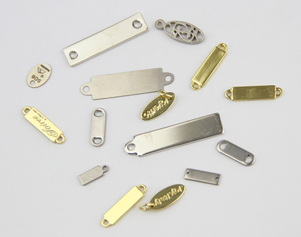 Variety of metal tags on grey gradient background