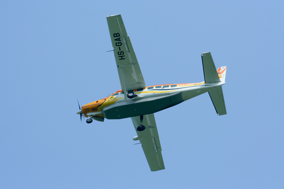 A private Bahamas air charter flies way overhead. Visitors will board one themselves on a day trip to Bahamas air tours.