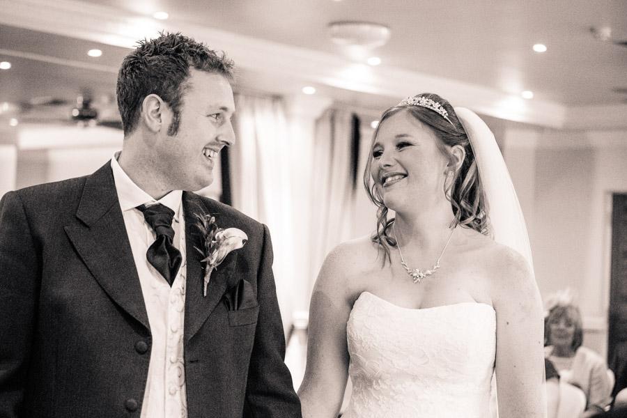 Black and white ceremony smiles