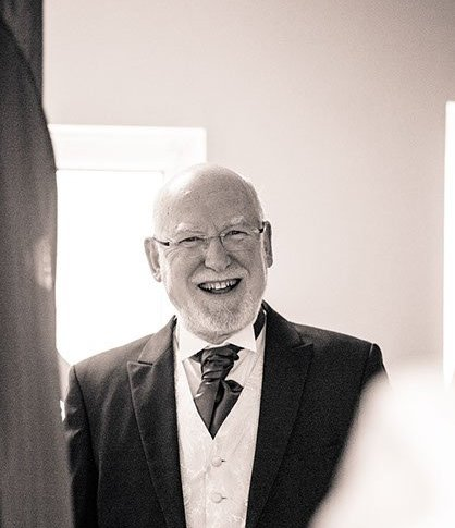 Father of the bride smiles