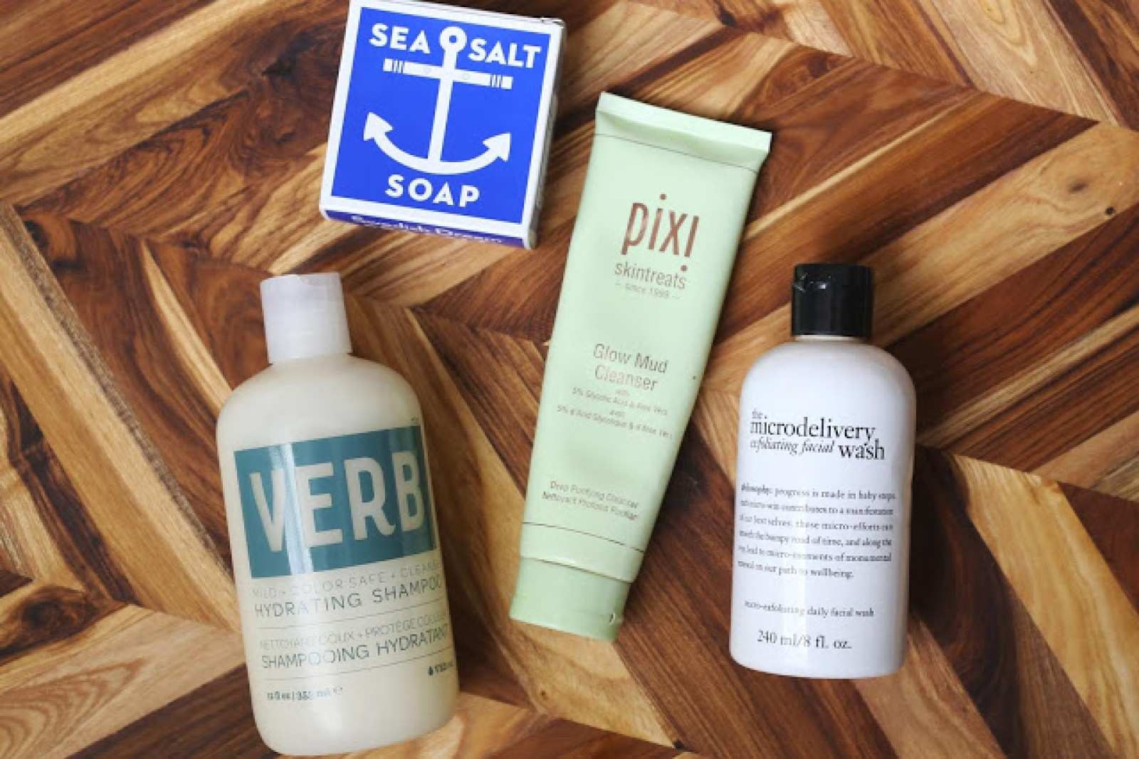 shower products laid out including sea salt soap, verb shampoo, pixi mud cleanser and philosophy exfoliating wash