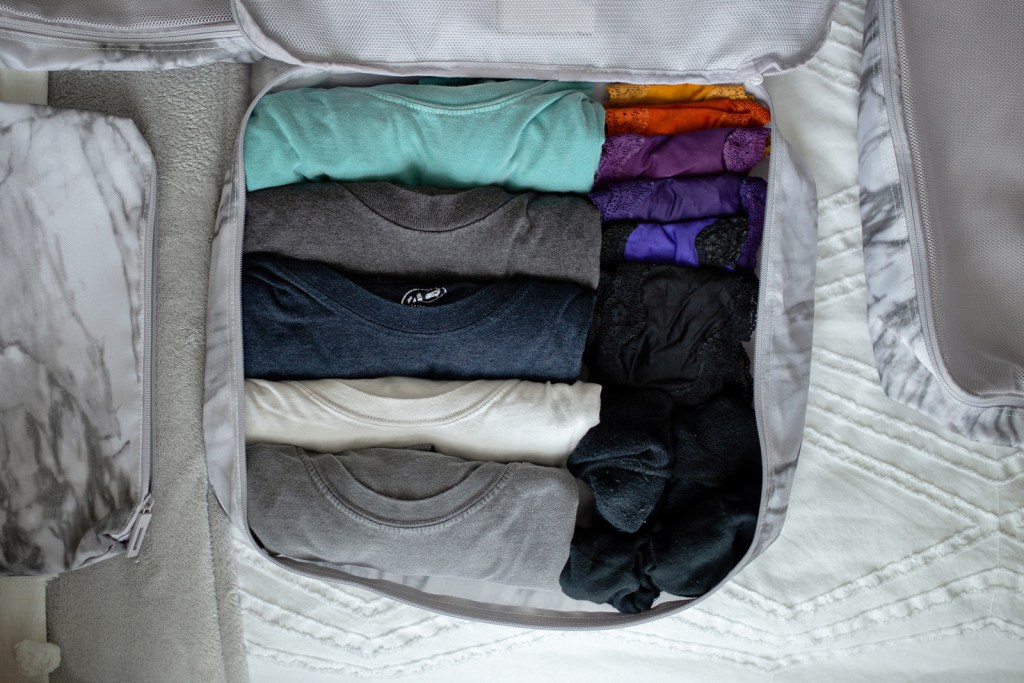suitcase all prepped and ready to travel after organizing with Calpak packing cubes.