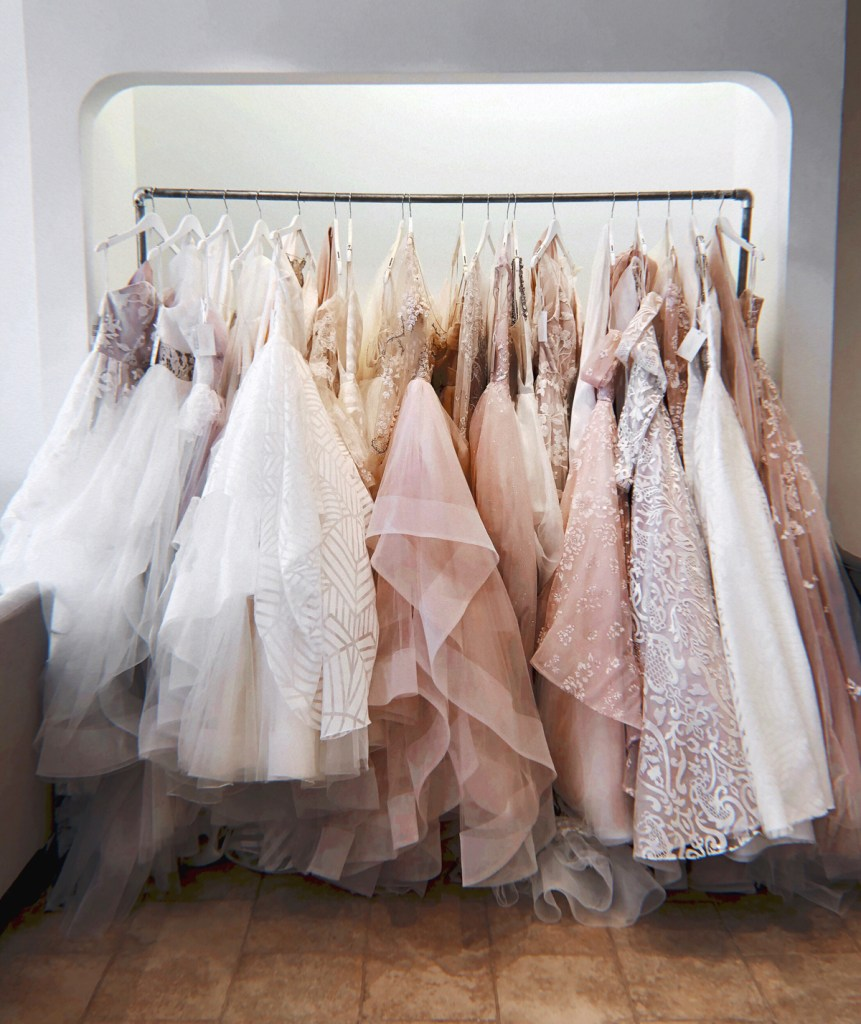 racks of Hayley Paige dresses at Coastal Knot bridal
