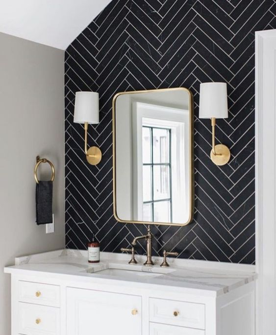 black and white bathroom vanity with gold scones