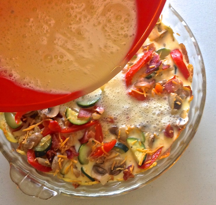custard being poured over the vegetables