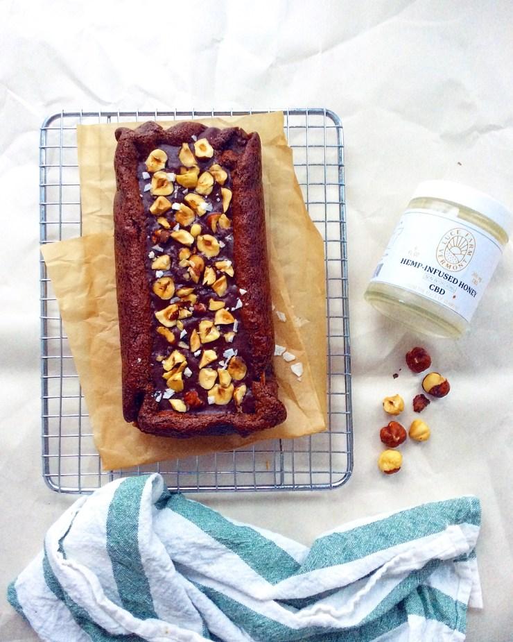 Flourless Hazelnut Brownies with Hemp-Infused Honey Ganache