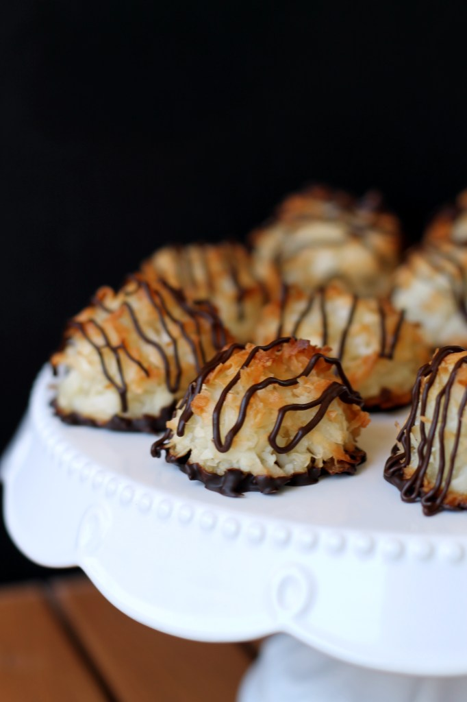 These Black-Bottomed Coconut Macaroons are the perfect balance of chewy and crunchy. They're naturally gluten-free, and dipped and drizzled with chocolate!