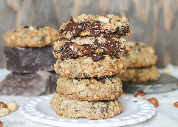 These Nutella Stuffed Oatmeal Hazelnut Chocolate Chip Cookies are loaded with dark chocolate and sprinkled with sea salt. Crunchy toasted hazelnuts and Nutella make these chewy oatmeal chocolate chip cookies even more drool worthy!